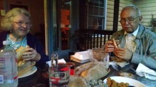Aunt Anne and Uncle John enjoying the pulled pork and coleslaw. Yum!