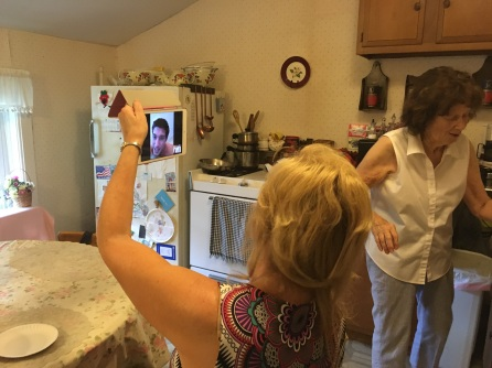 My sister-in-law and Mom talking with my nephew, his wife and baby (on the iPad).