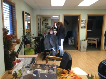 Harmony cutting Zeb's hair before the wedding.