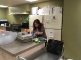 Lauren's mom setting up food stuff