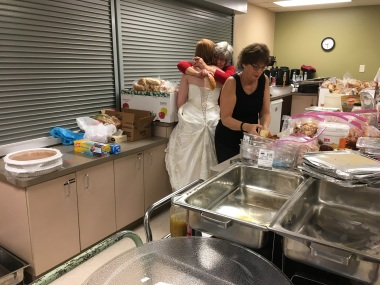 Nothing like a Grandma hug while cleaning up after the wedding.