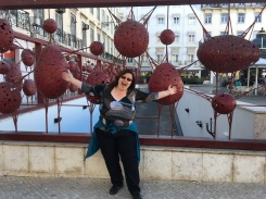 Lise enjoying art in the city.